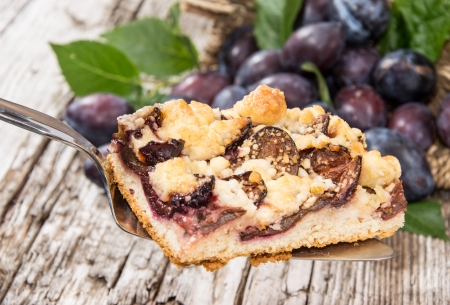 Plum Cake on a lifter with fresh fruits in the background Stock Photo - 15023525