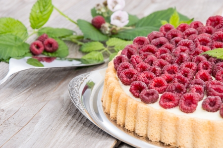 Raspberry Tart against wooden background photo
