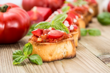 Fresh made Antipasti (Bruschetta) on wooden background