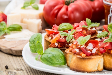 Bruschetta on a plate (macro shot) against wooden background