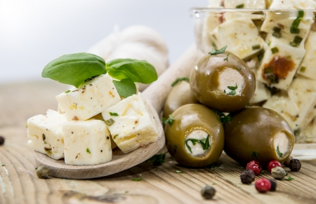 Feta Cheese and Olives on wooden background photo