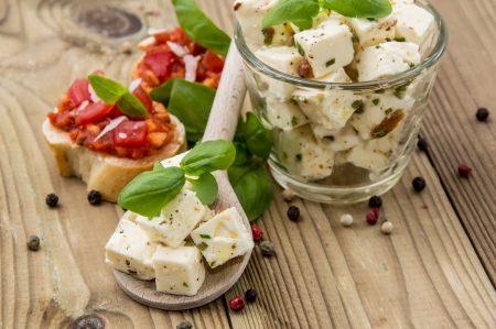 feta: Feta Cheese and Olives on wooden background