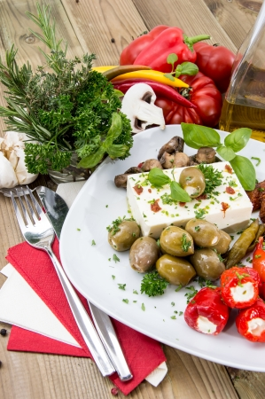 Mixed Antipasto on a plate against wood photo