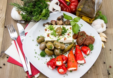 Fresh Antipasto on a plate against wood photo