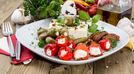 antipasto: Fresh Antipasto on a plate against wood