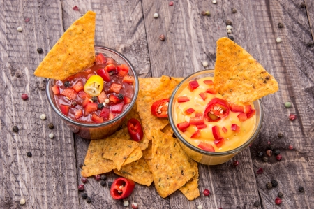 Glasses with Salsa- and Cheese Sauce on wooden background photo