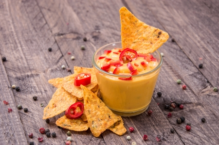 Fresh Cheese Sauce with Nachos on wooden background photo