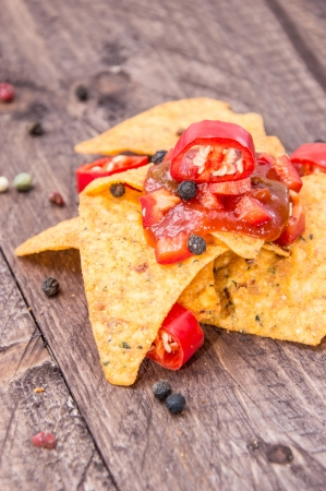 Some Nachos with Salsa Sauce on wooden background photo