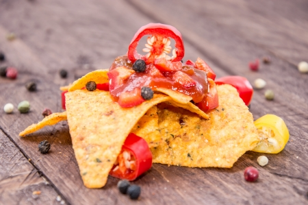 Heap of Nachos with Salsa Sauce on wooden background photo