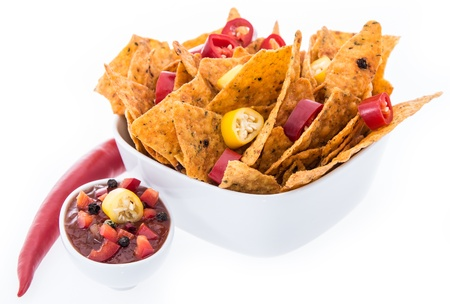 Bowl with Nachos isolated on white background photo