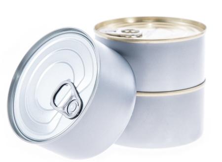 Algunas latas aislados en fondo blanco Foto de archivo