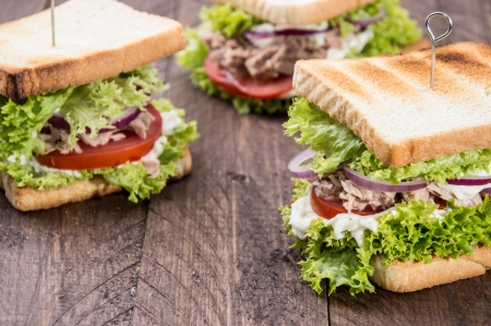 Fresh made Tuna Sandwiches on wooden background photo