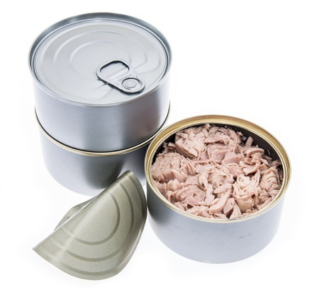 Tuna fish in a can isolated on white photo