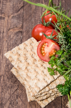 crust crusty: Crispbread with fresh Herbs on wooden background Stock Photo