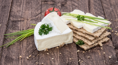 Crispbread with Camembert on wooden background photo