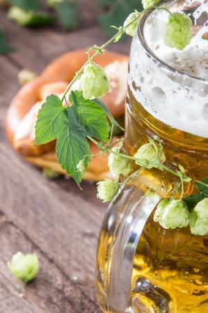 Mug of Beer with hop (macro shot) on wooden background Stock Photo - 15469814