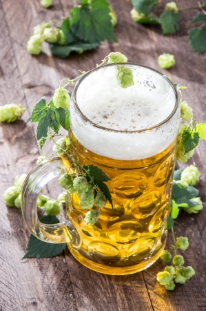 Beer with Hops on wood photo