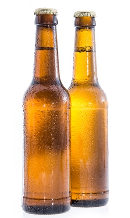 Two wet bottles of Beer isolated on white background photo