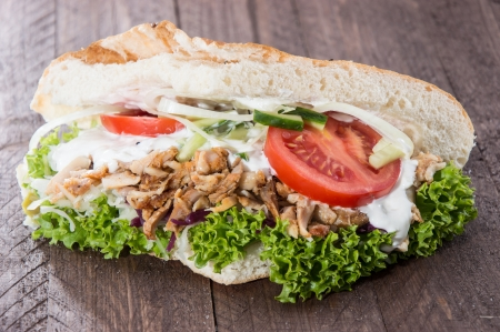 Pita bread and Kebab meat on wooden background Imagens