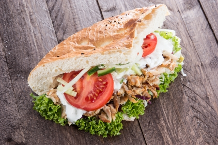 Pita bread and Kebab meat on wooden background photo