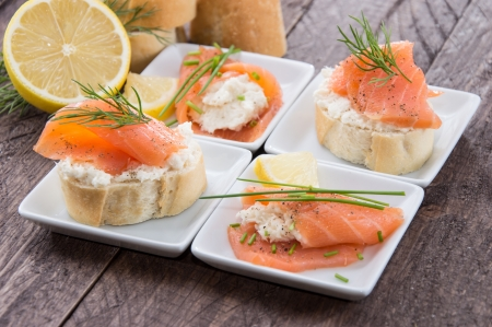 Salmon and Horseradish on a Baguette topped with herbs photo