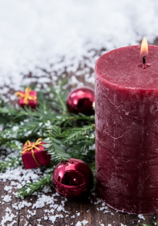 Rustical red Candles in the snow photo