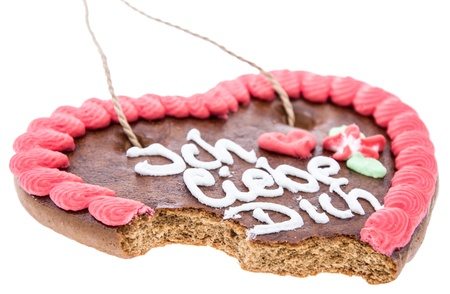 Bitten off Gingerbread Heart isolated on white background photo