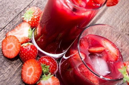 Strawberry Liqueur with fresh fruits on wooden background Stock Photo - 16157773