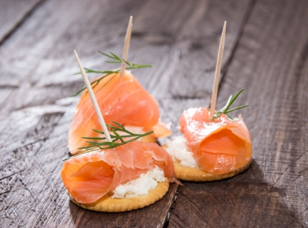Crackers with Salmon and Dill on wooden background photo