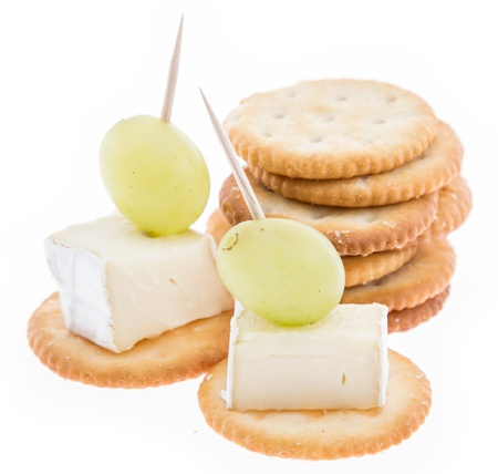 Crackers with Camembert isolated on white background