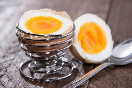 Halved egg on wooden background Stock Photo - 16553017