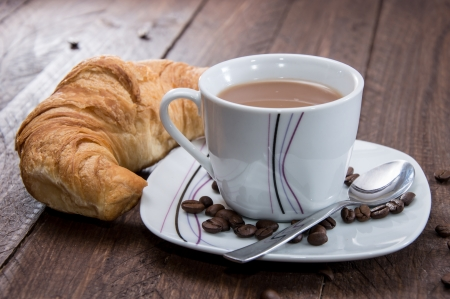 traditionally french: Breakfast with Coffee and Croissant on wood