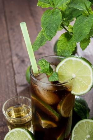 longdrink: Longdrink in a glass on wooden background