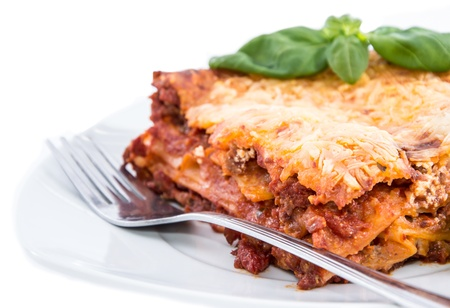 Piece of Lasagne isolated on white background photo