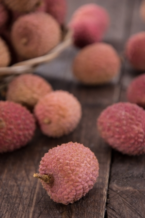 lychees: Fresh Lychees (macro shot) on wooden background