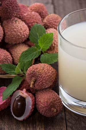 Lychee Juice with fresh fruits on wooden background Stock Photo - 17072198