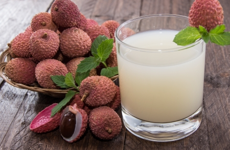 lychee juice: Fresh made Lychee Juice on wooden background Stock Photo