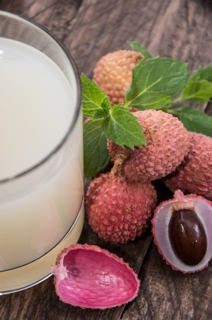 lychee juice: Lychee Juice with fresh fruits on wooden background