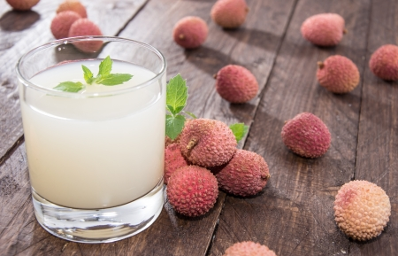 lichee: Fresh made Lychee Juice on wooden background Stock Photo