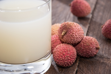Lychee Juice with fresh fruits on wooden background Stock Photo - 17072059