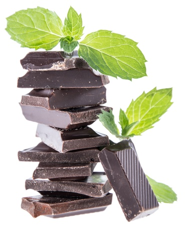 Stacked Chocolate with Mint isolated on white photo