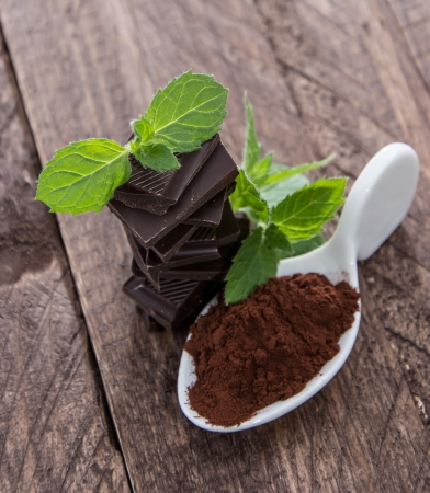 Chocolage, Mint and Cocoa on wooden background photo
