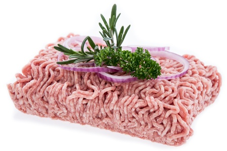 Block of Minced Meat with fresh Herbs on white photo