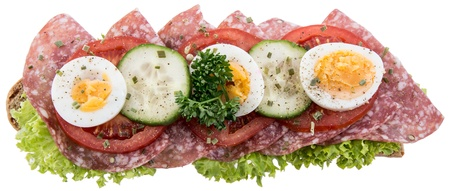 Salami Sandwich decorated with vegetables isolated on white background photo