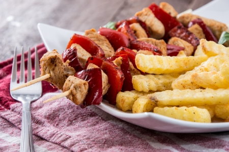 Fresh grilled Skewer with french fries on wooden background Stock Photo - 17072572