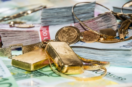 Euro bills and Gold (bullions and jewellery) photo
