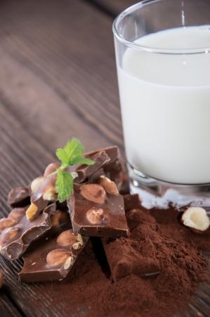 Hazelnut Chocolate and Milk on wooden background photo