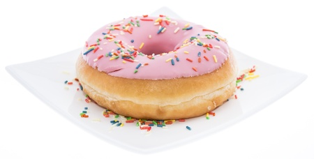 Pink Donut on a plate isolated on white background  photo