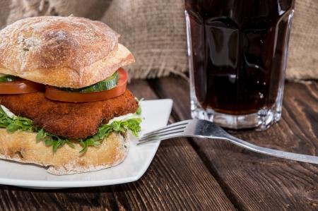 chicken sandwich: Chicken Sandwich on a plate (wooden background)