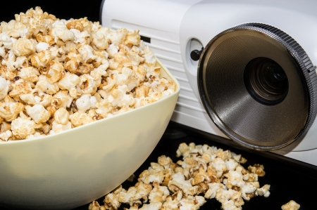 Home Cinema projector with fresh made Popcorn photo